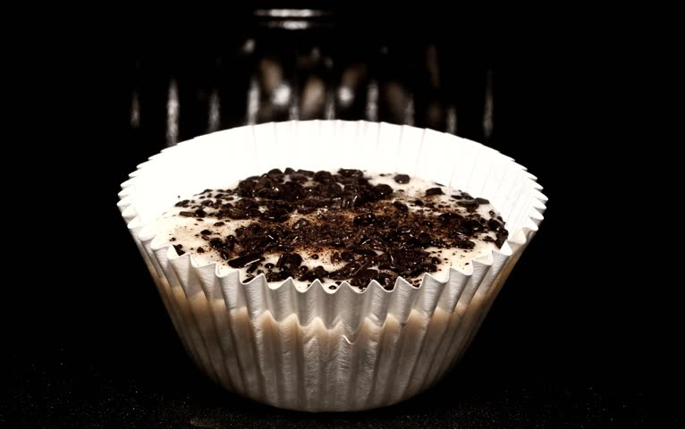Cupcake; Oven baking muffin timelapse   Baking in oven.  Very high contrast;