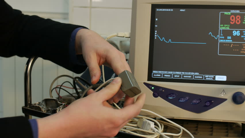 Patient With Pulse Oximeter On Finger For Monitoring - dolly shot