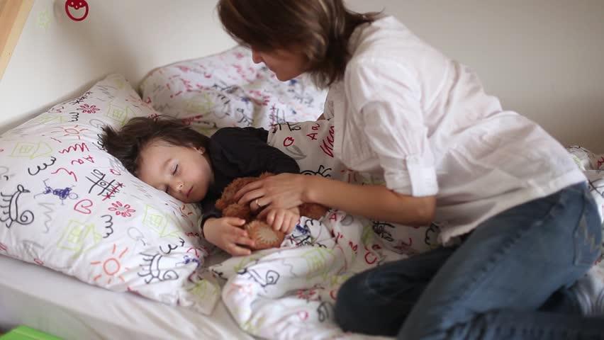 boy sleeping in bed stock footage video shutterstock. Black Bedroom Furniture Sets. Home Design Ideas