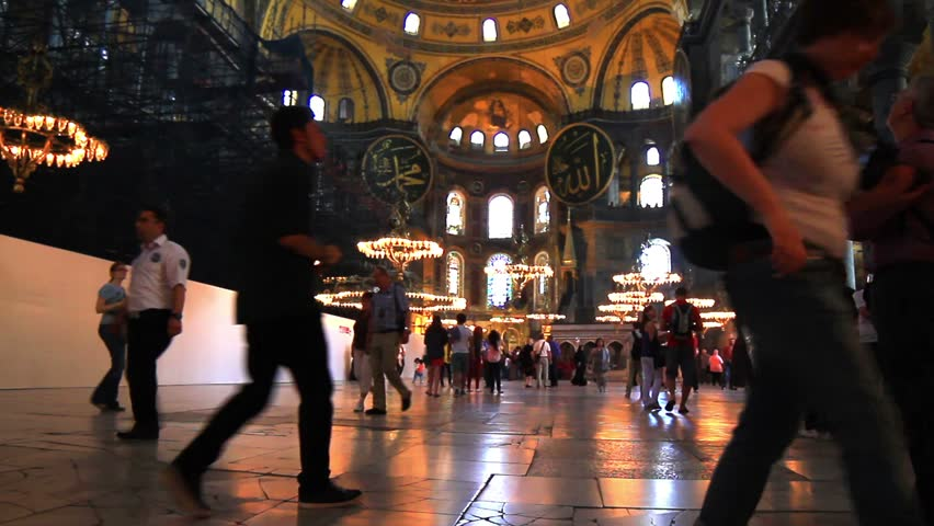 ISTANBUL - MAY 16, 2013: Interior of Hagia Sophia Basilica. Historical Church, a world wonder in Istanbul since it was built in 537 AD. Inside Hagia Sophia. Tilt from dome to the floor