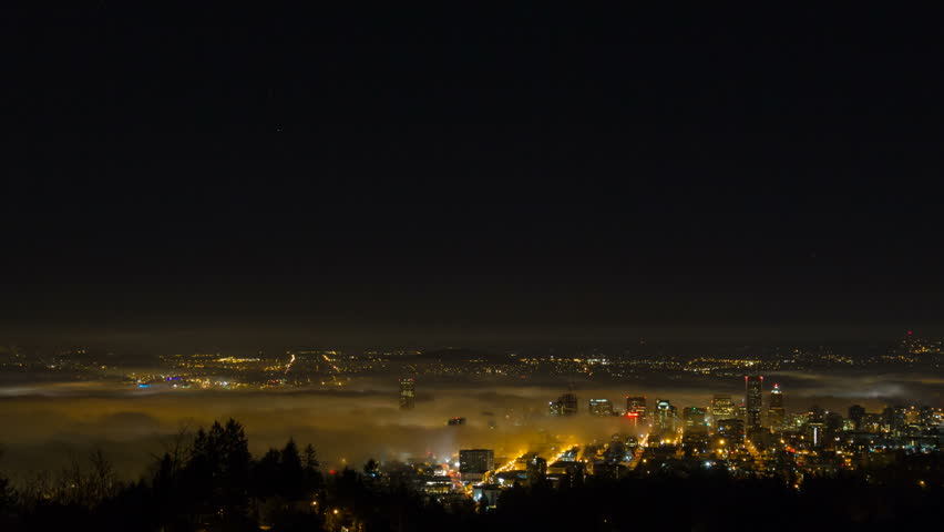 Time Lapse Movie of Thick Dense Rolling Fog Over Downtown City of Portland Oregon with Snow Covered Mount Hood One Early Winter Morning at Sunrise 1080p - HD stock footage clip
