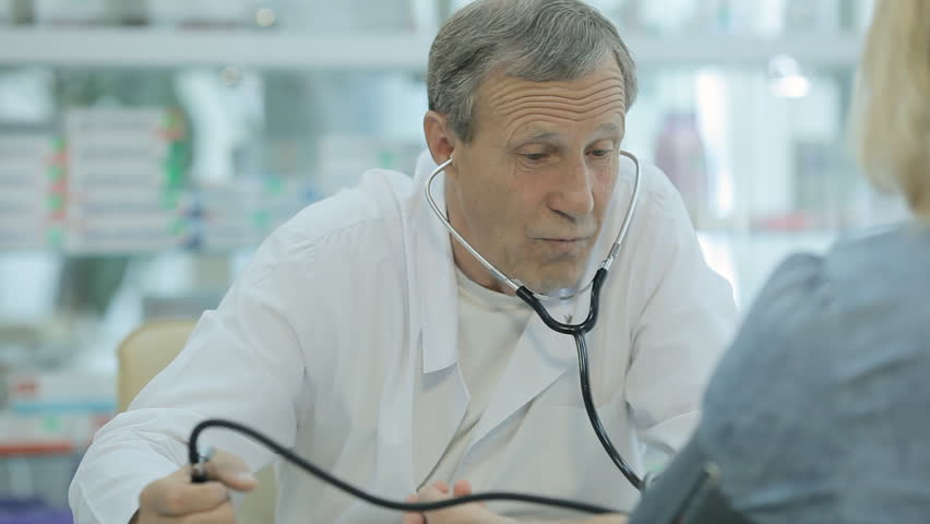 Close up of a doctor who measures the pressure of the patient