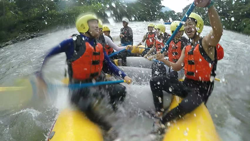 People Have Fun On Inflatable Raft Pulled By A Motor Boat