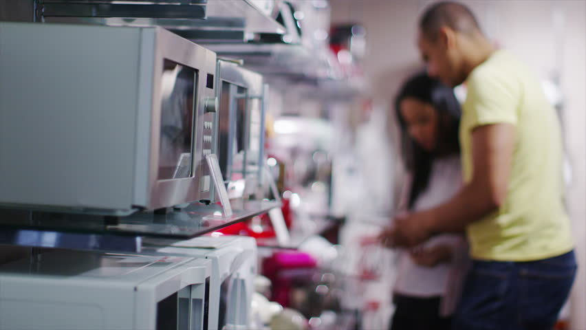 4K Couple shopping in a store selling kitchen appliances, white goods & electronic