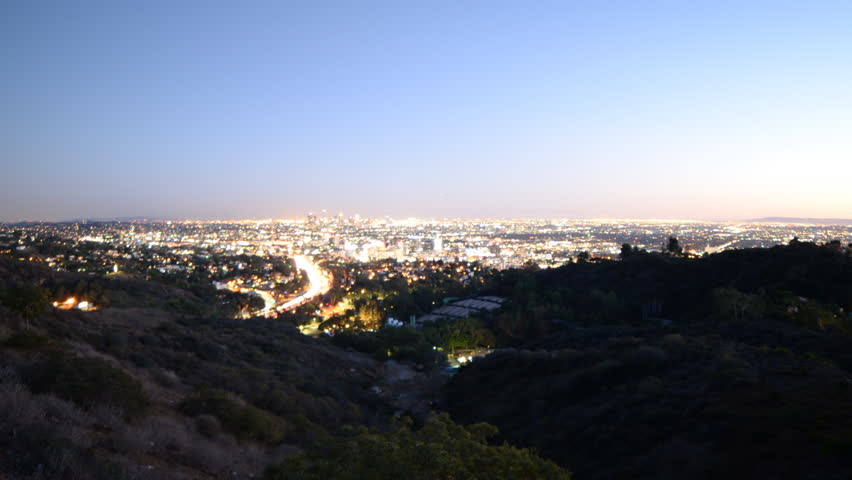 4K Time lapse footage of Los Angeles cityscape at twilight wide shot in Los Angeles, California