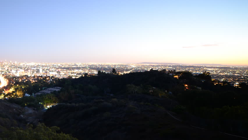 Time lapse footage with pan right motion of Los Angeles cityscape at twilight wide shot in Los Angeles, California