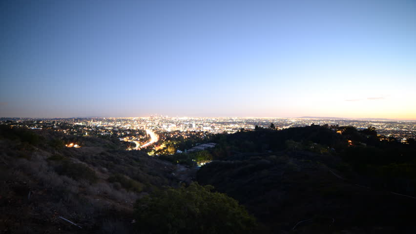 Time lapse footage with tilt down motion of Los Angeles cityscape at twilight wide shot in Los Angeles, California