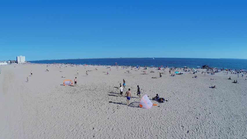 NEW-YORK - AUG 24, 2014: Man scores a goal during play on Brighton Beach at summer sunny day. Aerial view. Brighton Beach is an oceanside neighborhood with population about 76000 people. - HD stock video clip