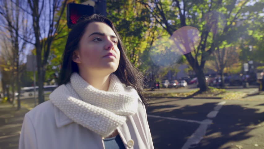 Mixed Race Young Woman, Waits For Light To Change, To Cross The Street In City