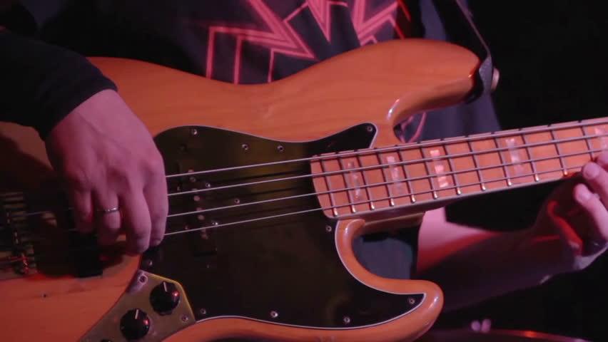 Bass guitar player and drummer