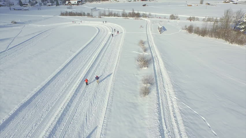 AERIAL: Cross-country skiing on a sunny winter day