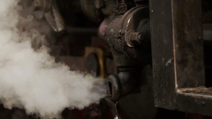 Steam Leak From Pipe : Historic steam train waiting in rural station for