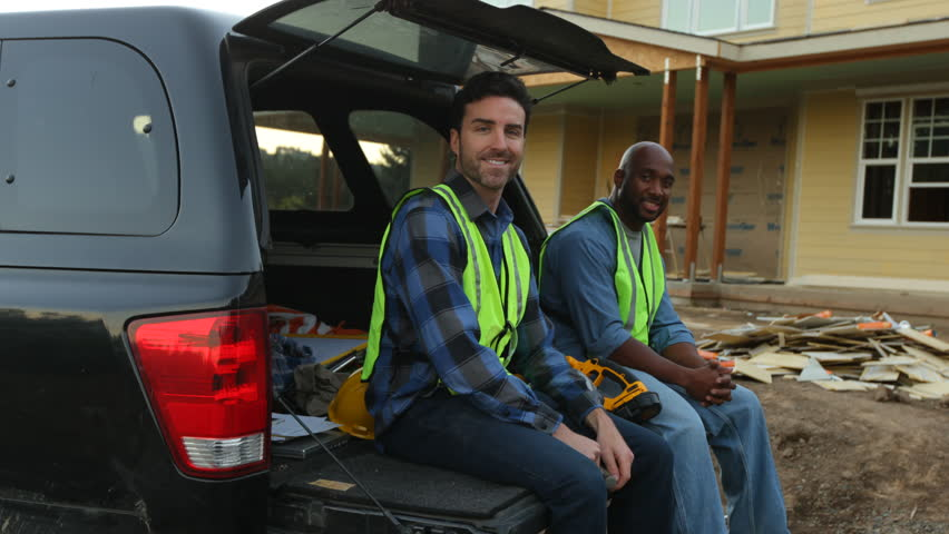Portrait of two construction workers