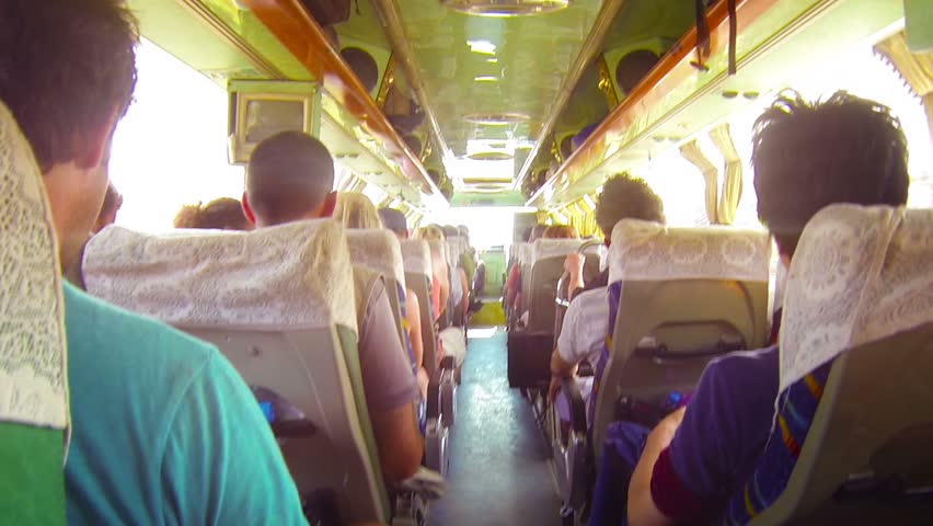 Video FullHD - Fully loaded passenger bus bounces and lurches over a poorly maintained roadway. providing cheap transportation in Southeast Asia.