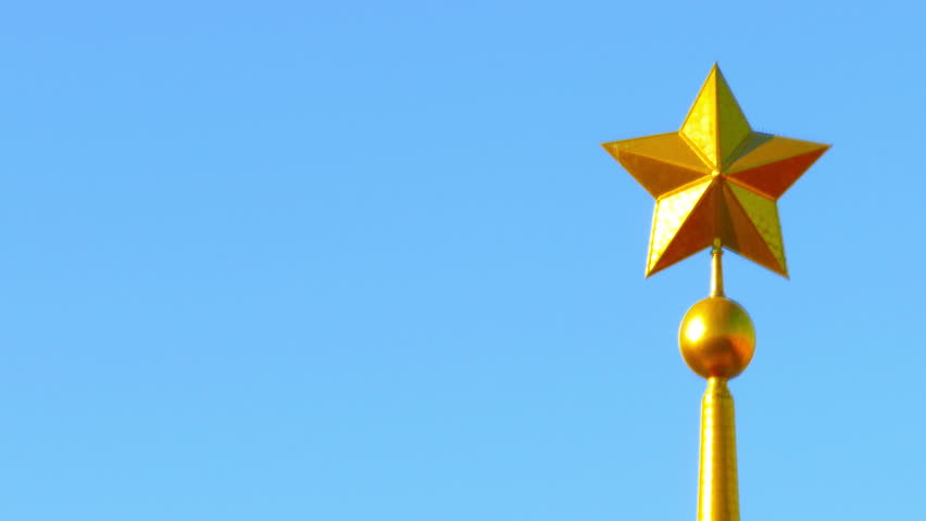 Metal star on top of the obelisk on a background of blue sky