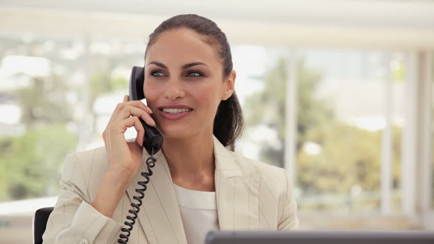 Businesswoman Using a Phone at the Office - HD stock footage clip