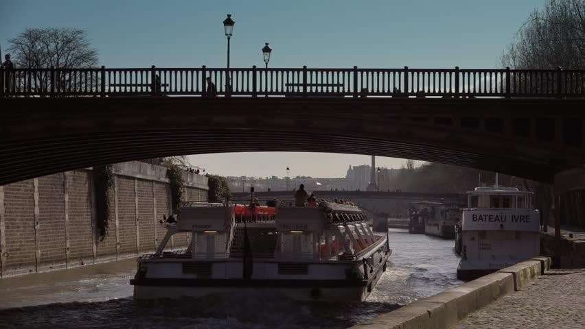 paris france march 04 tour boat in seine river paris 60fps tour boat on famous spot in. Black Bedroom Furniture Sets. Home Design Ideas