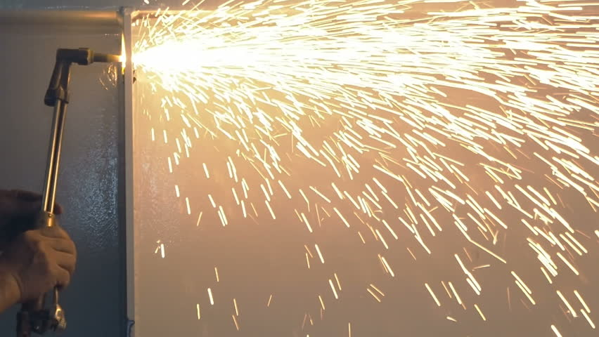 Industrial worker cutting steel by using metal torch, 60 fps.  - HD stock footage clip