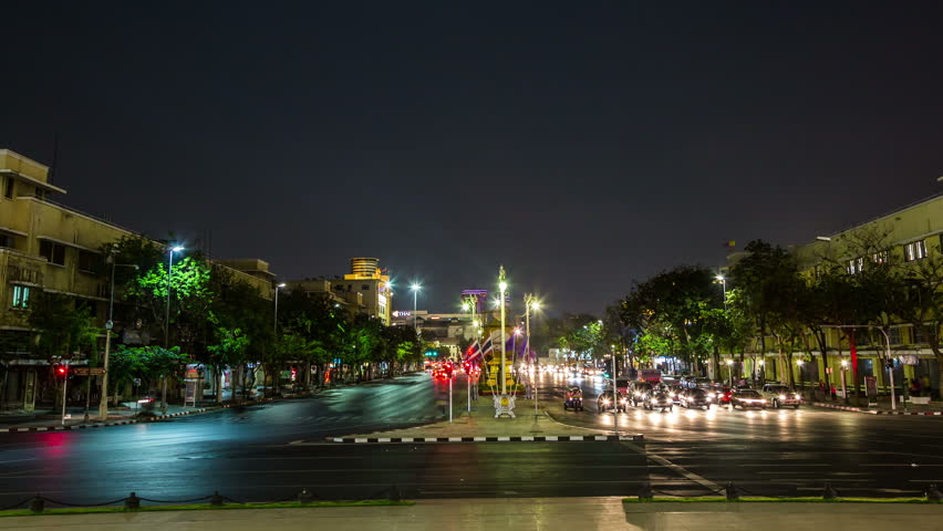 BANGKOK, THAILAND – March 5, 2015: Ratchadamnoen Klang Road with driving cars by night - DSLR Timelapse zoom out