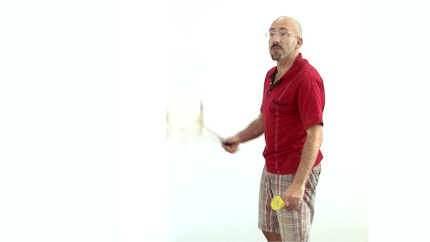 a bald man in a red shirt gets ready to play badminton,tennis,energetically Bouncing and waving his arms and communicates with facial expressions on the face. fades to white