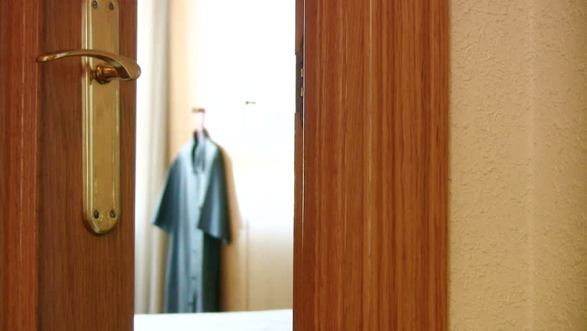 "Man hangs ""Do Not Disturb"" sign on a hotel room door - HD stock footage clip"