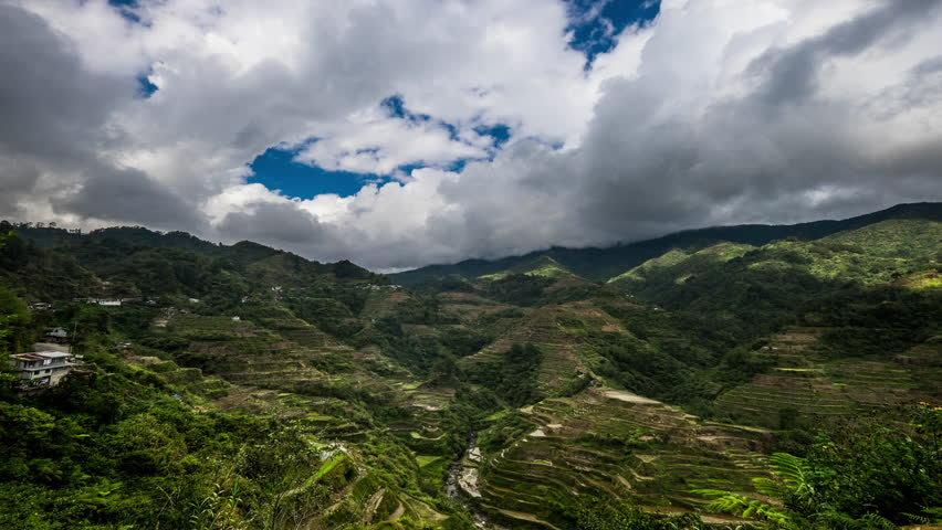 Time lapse of cloudy blue sky over rice terraces fields in Ifugao province mountains. Philippines UNESCO heritage