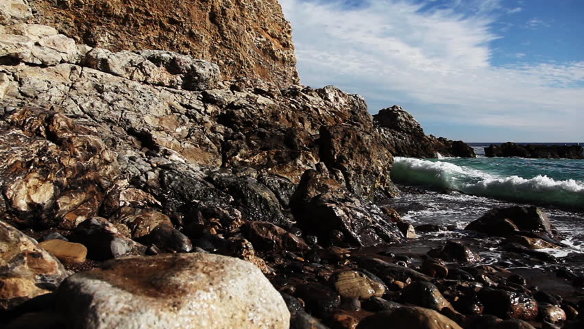 Close up waves crashing on rocky beach. Rancho Palos Verdes, Los Angeles, California. Shot in 1080p HD. - HD stock video clip
