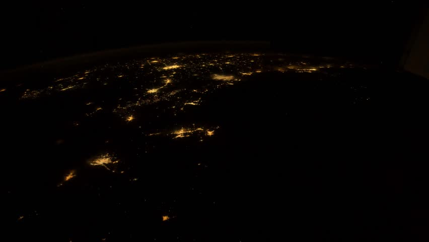 Beautiful view of our home planet Earth in a timelapse video where city lights, clouds and the sea can be seen. Elements of the image furnished by NASA in January 2015
