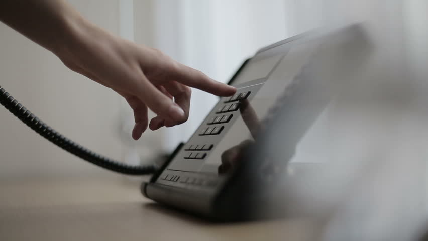 Phone in a hotel room or office. Close up - HD stock footage clip