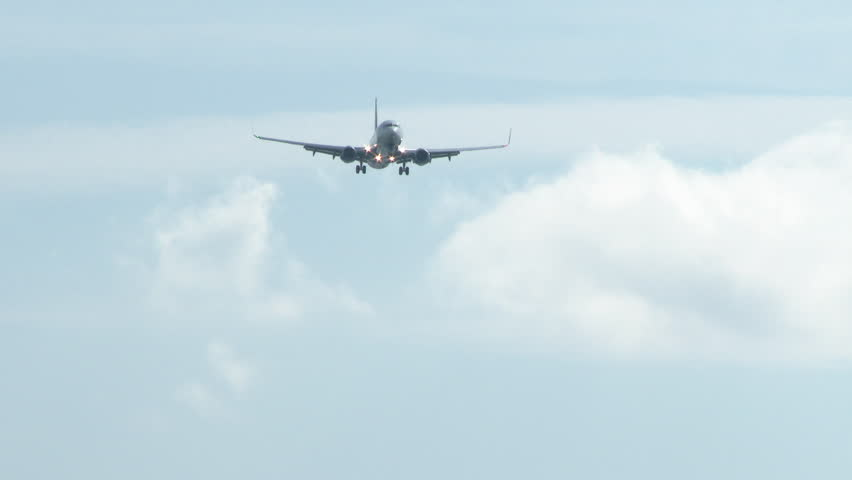 Commercial airline flying by as it comes in for a landing.