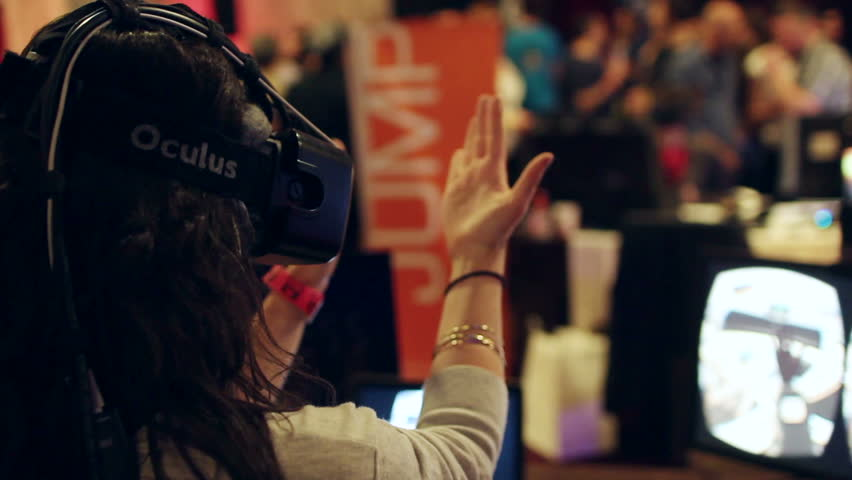 LOS ANGELES - MAR 22, 2015: Tech enthusiasts demo the Leap Motion on Oculus Rift in virtual reality at the VR Los Angeles Expo in Los Angeles on March 22, 2015.