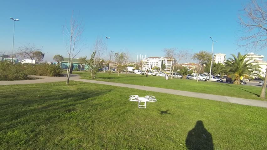 ISTANBUL - AUG 01, 2014: DJI Phantom quadcopter drone rises up. Remote controlled multicopters often used in aerial action video. Remote controlled toy quadcopter - Take off