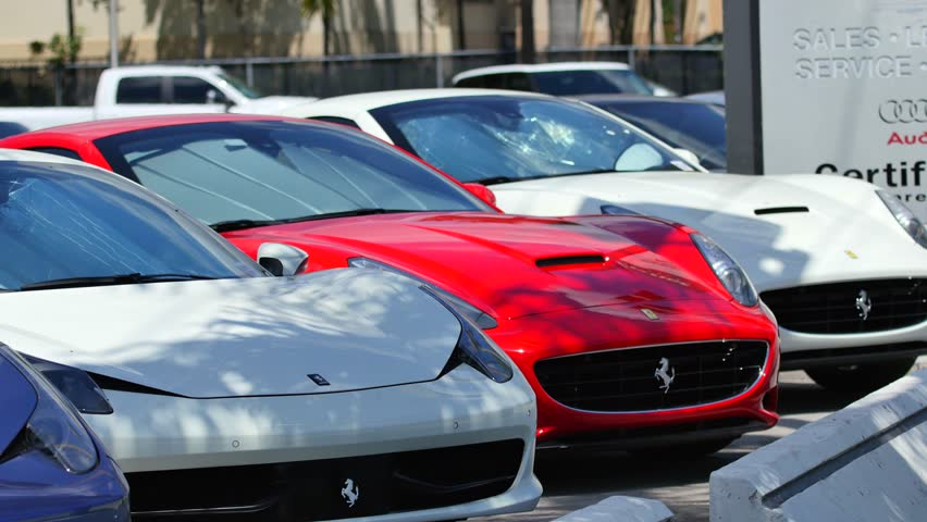 MIAMI - APRIL 6, 2015: 4k video of Ferrari cars for sale at a dealership in Miami. Ferrari was founded by Enzo Ferrari in 1929 April 6, 2015 in Miami FL - 4K stock video clip