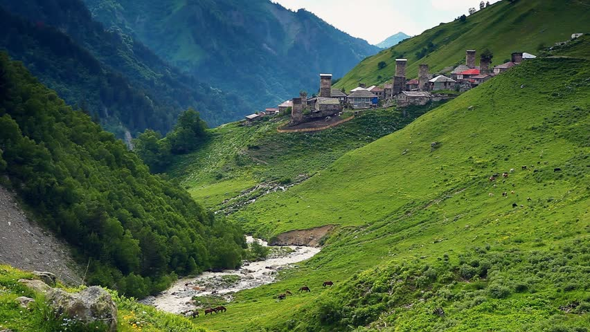 Majestic view of the old village Adishi, Upper Svaneti, Mestia, Georgia, Europe. Caucasus ridge. Dramatic unusual scene. Beauty world. HD video (High Definition)
