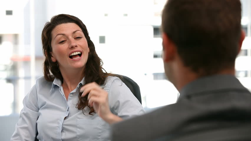 Appointment between a businesswoman and a businessman in the office