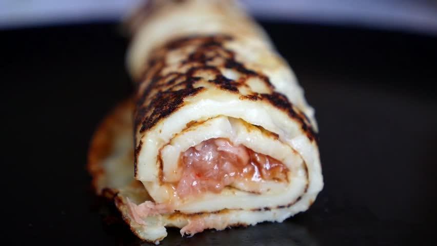 Eating Tuna Fish in Pancake Roll on Plate. Closeup. HD, 1920x1080.