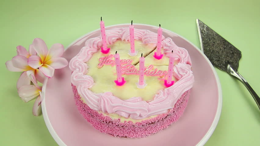 Edited sequence of birthday cake candles being blown out then the cake sliced. - HD stock footage clip