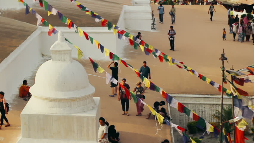KATHMANDU, NEPAL, CIRCA MAY 2014 - Locals and tourists visit Boudhanath Stupa circa May 2014 in Kathmandu, Nepal. Boudhanath is a UNESCO World Heritage Site and one of the largest stupas in the world. - HD stock footage clip