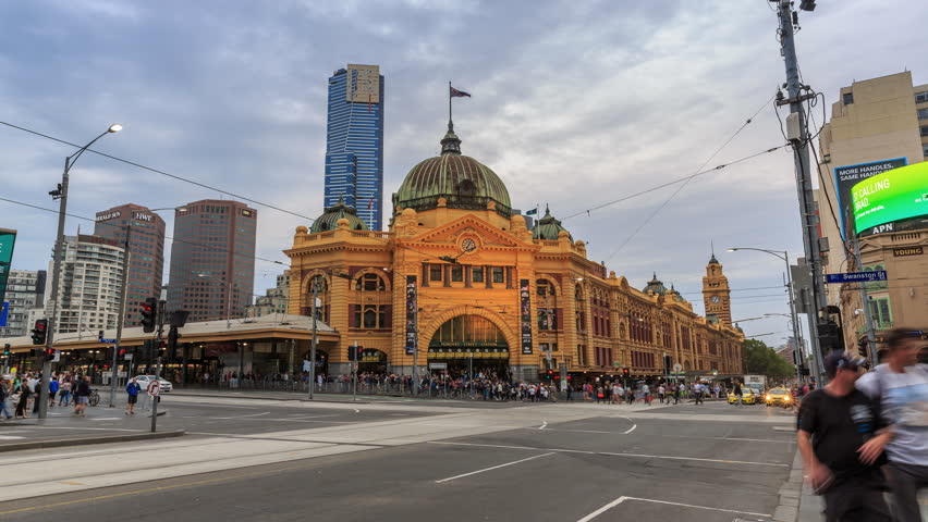 MELBOURNE, AUSTRALIA - MAR 14: 4K Day to Night timelapse video of Flinders street station on Mar 14, 2015 in Melbourne. It is the busiest station on Melbourne's metropolitan network.